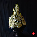 Beautifully shaped large wedding arrangement with white flowers made by The Flower Pot.
