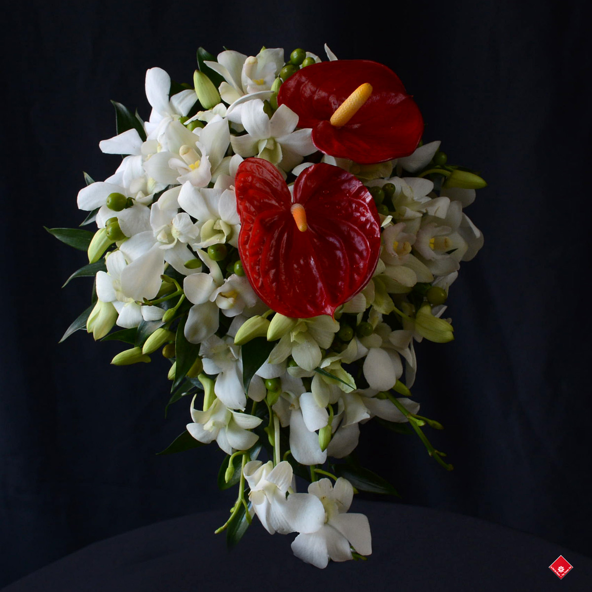 A beautiful red and white bouquet for the blushing bride.