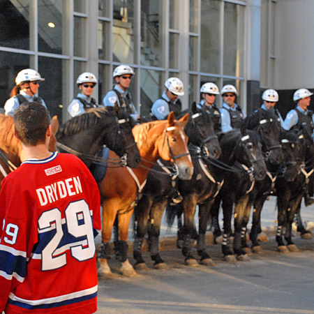 Police patrolling the Montreal Bell Centre on horse
