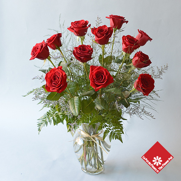 A dozen red roses in a beautiful vase.