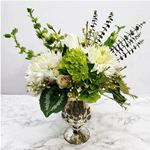 Natural looking arrangement in a urn vase.