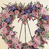 Heart shape wreath of delicate pastel flowers.