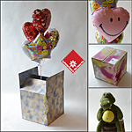 5 Mylar balloons in a hand-painted box.