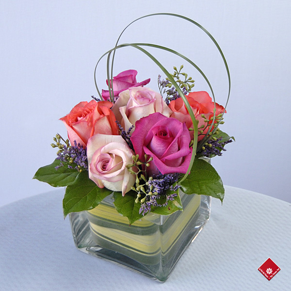 Rose gift of red roses in a square glass vase.