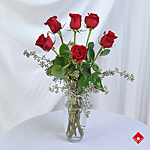 Valentine's Day gift of six red roses in a vase.