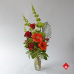 Red flower bouquet with roses and gerberas.