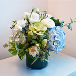 Gift for new born baby flower arrangement in a vase