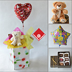 Balloon and bear in a box delivered across Canada.