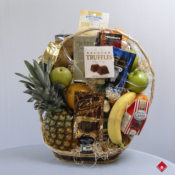 Assorted gourmet treats in a gourmet fruit gift basket.