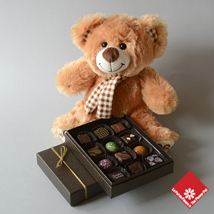 12 Chocolates and a Teddy.