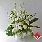White flower arrangement for wedding ceremony.
