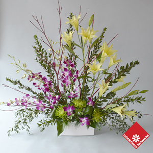 Table arrangement with dendrobium orchids and lilies