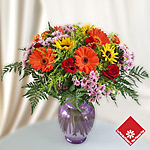 Colorful anniversary flowers in a vase.