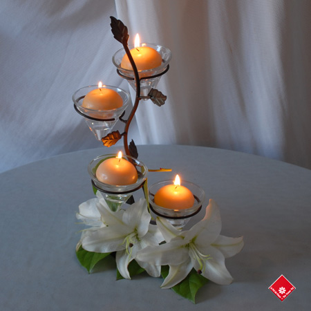 Decorative iron candle holder with fresh white lilies.