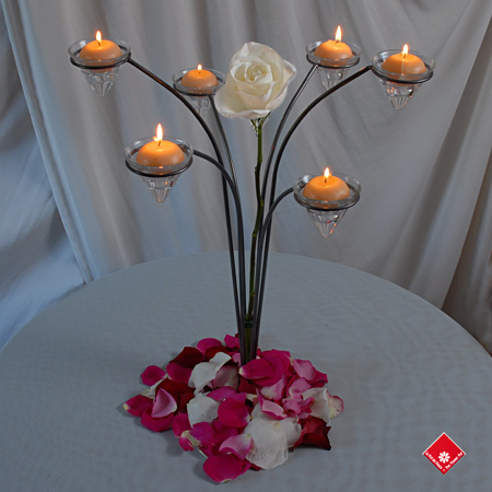 Candle decoration with fresh roses for your Montreal home.