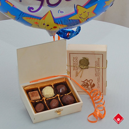 Chocolate gift with a festive mylar balloon.