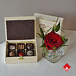 Handmade chocolates & truffles and a rose.