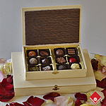 Quebec chocolates and truffles in a wooden gift box.
