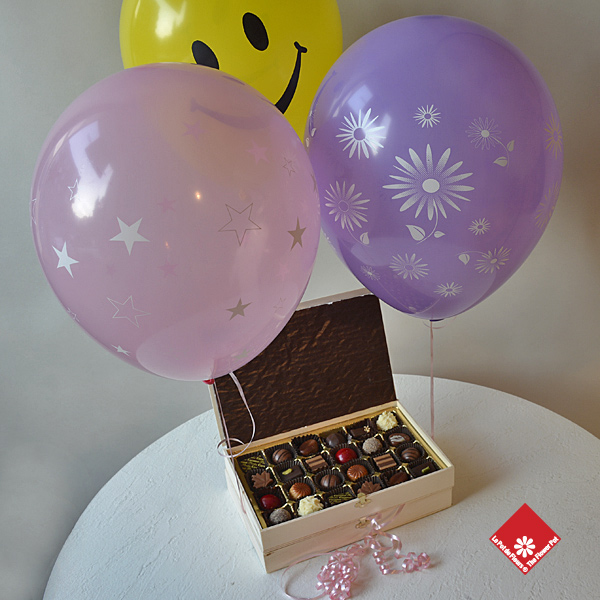 Chocolate gift with festive balloons.