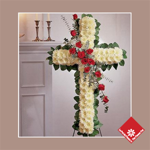 Red roses and chrysanthemums, traditional floral cross.