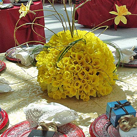 Table centerpiece of daffodils