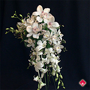 Cascading bridal bouquet with a variety of orchids.
