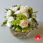 Monochrome arrangement combining roses, lisianthus and much more.
