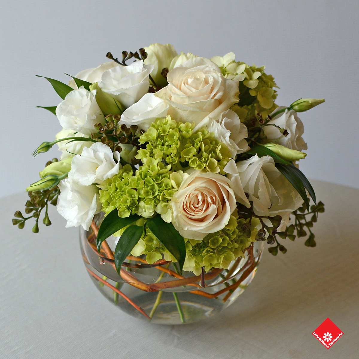 An elegant choice for a wedding centrepiece, birthday bouquet, intimate floral offering made up of cream and white coloured roses.