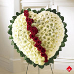 Funeral flowers arranged in a broken heart.