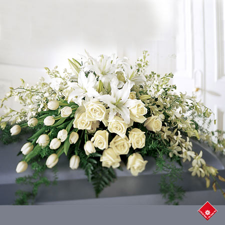 White casket flowers for a Montreal funeral.