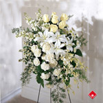 Funeral flower spray of elegant white flowers.