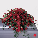 Red roses in a casket spray.
