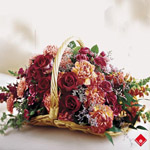 Sympathy basket of warm colored blooms.