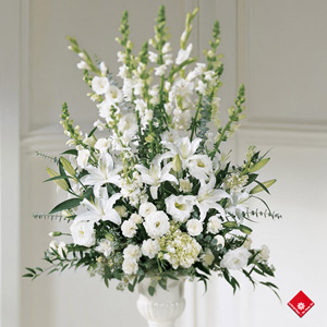 White flower arrangement for wedding ceremony from The Flower Pot.