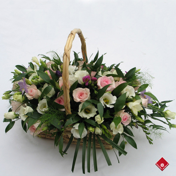 Garden basket of pastel-colored blooms for a funeral.