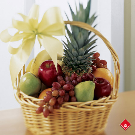 Fresh fruit in a decorative gift basket.