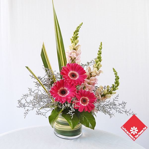 Triangular pink gerbera arrangement.