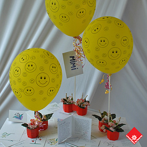 "Happy Face Balloon and a ""Floragramme"" greeting card to get your message across."