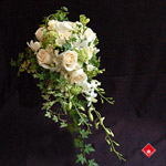 Cascading bridal bouquet with white flowers.