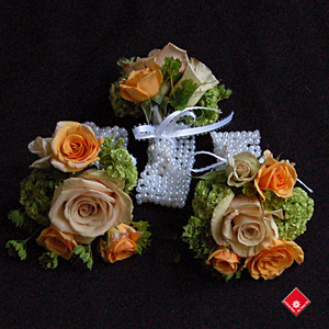 Rose wrist corsages with pearl wristband for Montreal Wedding.