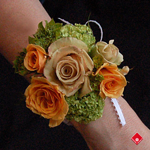 Rose wrist corsage with a pearl wristband for a Montreal wedding.