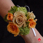 Rose wrist corsage with a beaded pearl wristband.