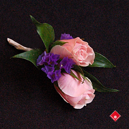Spray rose boutonniere for the ring bearer - The Flower Pot.