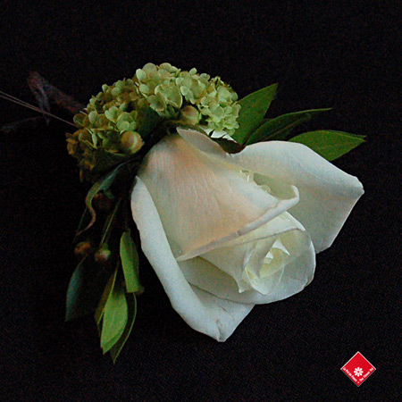 White rose boutonniere for a Montreal wedding - The Flower Pot.