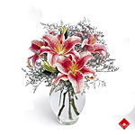 Oriental lilies in a glass vase.