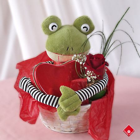 Romantic gift with stuffed animal, red rose, and chocolate.