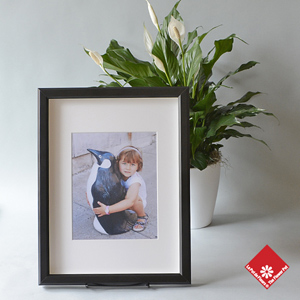 Your photo card with a decorative potted plant.
