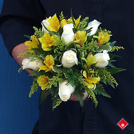 Alstroemerias and roses in a maid of honor bouquet.
