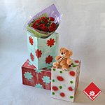 A dozen roses + teddy in a painted box