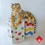 Tiger in a hand-painted box.